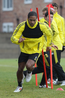 LIVERPOOL, ENGLAND - DECEMBER 14:  Glen Johnson of Liverpool sprints during a training session ahead of their UEFA Europa League Group K match against Utrecht at Melwood Training Ground on December 14, 2010 in Liverpool, England.  (Photo by Clive Brunskil