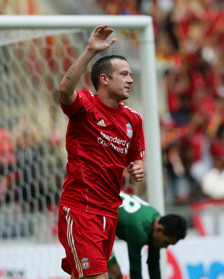 KUALA LUMPUR, MALAYSIA - JULY 16:  Charlie Adam of Liverpool celebrates after scoring during the pre-season friendly match between Malaysia and Liverpool at the Bukit Jalil National Stadium on July 16, 2011 in Kuala Lumpur, Malaysia. (Photo by Stanley Cho