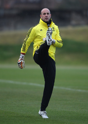 LIVERPOOL, ENGLAND - DECEMBER 14:  Pepe Reina of Liverpool stretches during a training session ahead of their UEFA Europa League Group K match against Utrecht at Melwood Training Ground on December 14, 2010 in Liverpool, England.  (Photo by Clive Brunskil