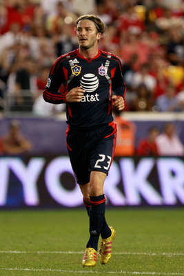 HARRISON, NJ - JULY 27: David Beckham #23 of the MLS All-Stars runs against the Manchester United  during the MLS All-Star Game at Red Bull Arena on July 27, 2011 in Harrison, New Jersey. Manchester United won 4-0. (Photo by Chris Trotman/Getty Images)