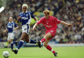 15 Sep 2001:  John Arne Riise of Liverpool gets his shot on target as Abel Xavier of Everton closes in during the FA Barclaycard Premiership match played at Goodison Park, in Liverpool, England. Liverpool won the match 3-1. \ Mandatory Credit: Shaun Botte