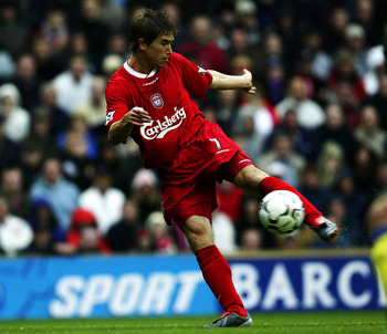 LIVERPOOL, ENGLAND - OCTOBER 4:  Harry Kewell of Liverpool scores the first goal during the FA Barclaycard Premiership match between Liverpool and Arsenal at Anfield on October 4, 2003 in Liverpool, England. (Photo by Clive Brunskill/Getty Images)