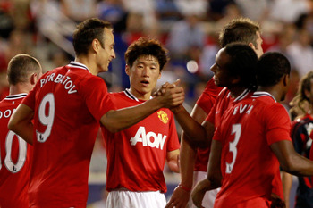 HARRISON, NJ - JULY 27:  Anderson #8 and Ji-Sung Park #13 of the Manchester United congratulate teammate Dimitar Berbatov #9 on his goal against the MLS All-Stars during the second half of the MLS All-Star Game at Red Bull Arena on July 27, 2011 in Harris