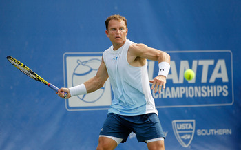 NORCROSS, GA - JULY 20:  Michael Russell plays a forehand during a match against Kevin Anderson of South Africa at the Atlanta Tennis Championships at the Racquet Club of the South on July 20, 2011 in Norcross, Georgia.  (Photo by Mike Ehrmann/Getty Image