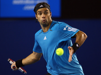MELBOURNE, AUSTRALIA - JANUARY 24:  Fernando Gonzalez of Chile plays a forehand in his fourth round match against Andy Roddick of the United States of America during day seven of the 2010 Australian Open at Melbourne Park on January 24, 2010 in Melbourne,
