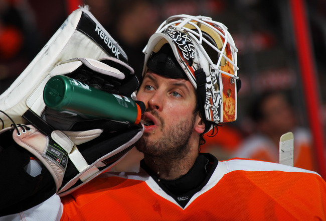 PHILADELPHIA, PA - APRIL 22:  Michael Leighton #49 of the Philadelphia Flyers takes a drink of water in the third period of Game Five of the Eastern Conference Quarterfinals against the Buffalo Sabres during the 2011 NHL Stanley Cup Playoffs at Wells Farg