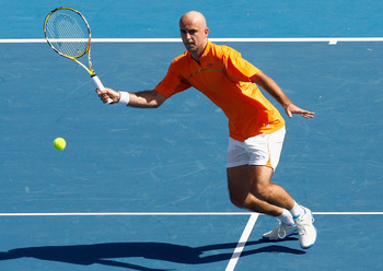 MELBOURNE, AUSTRALIA - JANUARY 14:  Ivan Ljubicic of Croatia plays a forehand volley during his match against Fernando Gonzalez of Chile during day one of the AAMI Classic at the Kooyong Lawn Tennis Club on January 14, 2009 in Melbourne, Australia.  (Phot