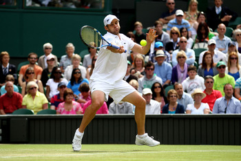 LONDON, ENGLAND - JUNE 24:  Andy Roddick of the United States returns a shot during his third round match against Feliciano Lopez of Spain on Day Five of the Wimbledon Lawn Tennis Championships at the All England Lawn Tennis and Croquet Club on June 24, 2