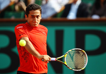 PARIS - JUNE 02:  Nicolas Almagro of Spain plays a forehand during the men's singles quarter final match between Rafael Nadal of Spain and Nicolas Almagro of Spain at the French Open  on day eleven of the French Open at Roland Garros on June 2, 2010 in Pa