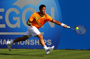 LONDON, ENGLAND - JUNE 07:  Fernando Verdasco of Spain reaches for a shot during his Men's Singles first round match against Nicolas Mahut of France on day two of the AEGON Championships at Queens Club on June 7, 2011 in London, England.  (Photo by Clive
