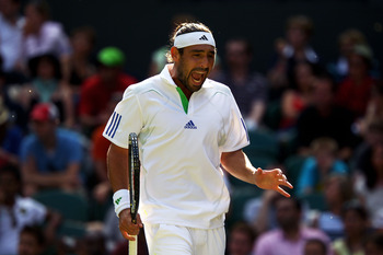 LONDON, ENGLAND - JUNE 25:  Marcos Baghdatis of Cyprus reacts to a play during his third round match against Novak Djokovic of Serbia on Day Six of the Wimbledon Lawn Tennis Championships at the All England Lawn Tennis and Croquet Club on June 25, 2011 in