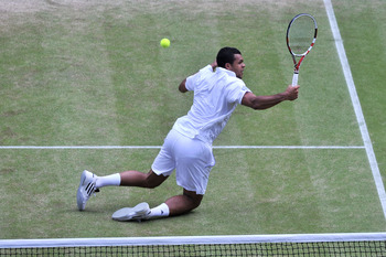 LONDON, ENGLAND - JULY 01:  Jo-Wilfried Tsonga of France in action during his semifinal round match against Novak Djokovic of Serbia on Day Eleven of the Wimbledon Lawn Tennis Championships at the All England Lawn Tennis and Croquet Club on July 1, 2011 i