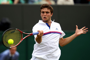 LONDON, ENGLAND - JUNE 25:  Gilles Simon of France returns a shot during his third round match against Juan Martin Del Potro of Argentina on Day Six of the Wimbledon Lawn Tennis Championships at the All England Lawn Tennis and Croquet Club on June 25, 201