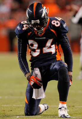 DENVER - NOVEMBER 28:  Wide receiver Brandon Lloyd #84 of the Denver Broncos collects his thoughts after a pass slipped through his fingertips in the fourth quarter against the St. Louis Rams at INVESCO Field at Mile High on November 28, 2010 in Denver, C