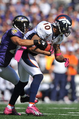 BALTIMORE, MD - OCTOBER 10:  Jabar Gaffney #10 of the Denver Broncos runs the ball against the Baltimore Ravens at M&T Bank Stadium on October 10, 2010 in Baltimore, Maryland. Players wore pink in recognition of Breast Cancer Awareness Month. The Ravens d