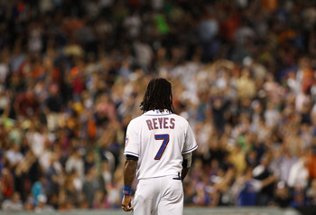 NEW YORK, NY - JUNE 22:  Jose Reyes #7 of the New York Mets walks to his position after making the third out against the Oakland Athletics on June 22, 2011 at Citi Field in the Flushing neighborhood of the Queens borough of New York City.  (Photo by Mike