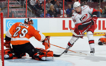 PHILADELPHIA - JANUARY 23:  Ray Emery #29 of the Philadelphia Flyers pokes the puck from Brandon Sutter #16 of the Carolina Hurricanes on January 23, 2010 at Wachovia Center in Philadelphia, Pennsylvania. The Flyers defeated the Hurricanes 4-2.  (Photo by