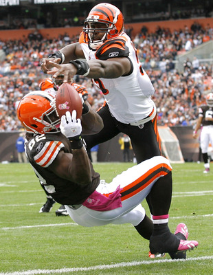 CLEVELAND - OCTOBER 03:  Linebacker Keith Rivers #55 of the Cincinnati Bengals breaks up a pass to tight end Benjamin Watson #82 of the Cleveland Browns at Cleveland Browns Stadium on October 3, 2010 in Cleveland, Ohio.  (Photo by Matt Sullivan/Getty Imag
