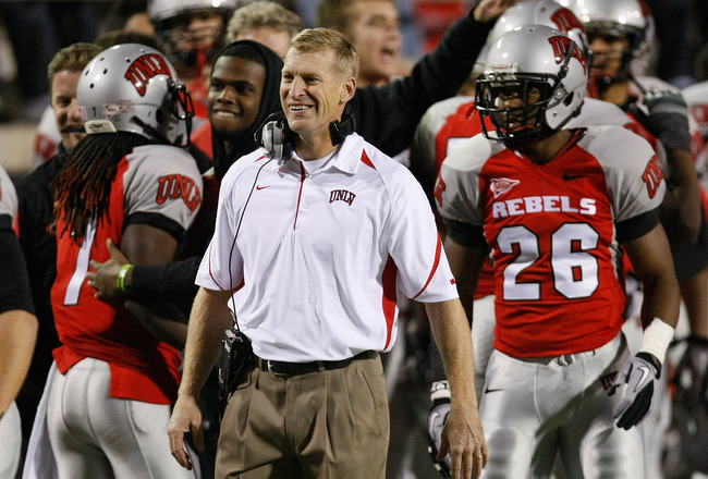 LAS VEGAS - NOVEMBER 18:  Head coach Bobby Hauck of the UNLV Rebels celebrates on the sideline after his team scored a touchdown against the Air Force Falcons at Sam Boyd Stadium November 18, 2010 in Las Vegas, Nevada. Air Force won 35-20.  (Photo by Etha