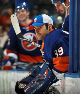 UNIONDALE, NY - MARCH 31: Rick DiPietro #39 of the New York Islanders watches the game against the New York Rangers from the bench at the Nassau Coliseum on March 31, 2011 in Uniondale, New York.  (Photo by Bruce Bennett/Getty Images)