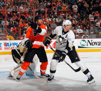 PHILADELPHIA, PA - MARCH 24:  Paul Martin #7 of the Pittsburgh Penguins and Scott Hartnell #19 of the Philadelphia Flyers battle for position during a game on March 24, 2011 at the Wells Fargo Center in Philadelphia, Pennsylvania.  (Photo by Lou Capozzola