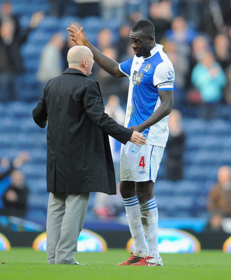 BLACKBURN, ENGLAND - MARCH 19:  Blackpool manager Ian Holloway speaks with Christopher Samba of Blackburn after the Barclays Premier League match between Blackburn Rovers and Blackpool at Ewood Park on March 19, 2011 in Blackburn, England.  (Photo by Mich