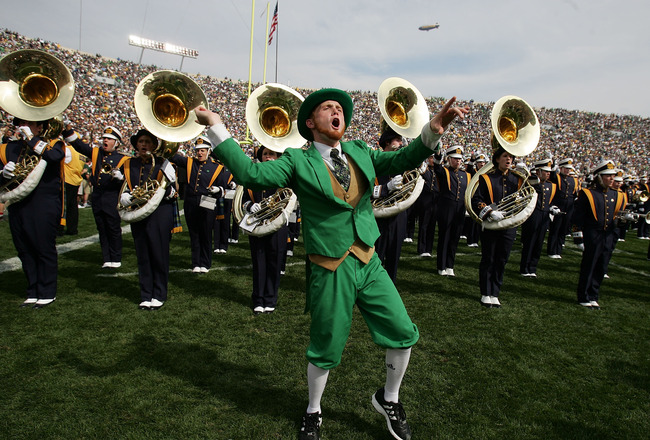 SOUTH BEND, IN - SEPTEMBER 16:  The Leprechaun from the Notre Dame Fighting Irish excites the crowd in front of the Notre Dame Marching band against of the Michigan Wolverines September 16, 2006 at Notre Dame Stadium in South Bend, Indiana. Michigan won 4