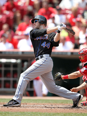 CINCINNATI, OH - JULY 28:  Jason Bay #44 of the New York Mets swings at a pitch during the game against the Cincinnati Reds at Great American Ball Park on July 28, 2011 in Cincinnati, Ohio.  (Photo by Andy Lyons/Getty Images)