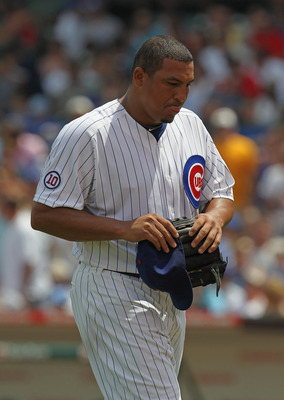 CHICAGO, IL - JULY 16:  Starting pitcher Carlos Zambrano #38 of the Chicago Cubs walks to the dugout after being taken out of a game against the Florida Marlins at Wrigley Field on July 16, 2011 in Chicago, Illlinois.  (Photo by Jonathan Daniel/Getty Imag