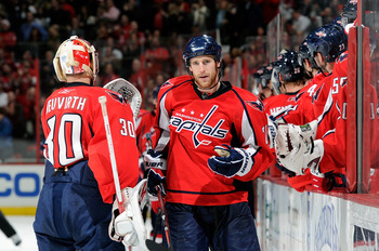WASHINGTON, DC - MARCH 01:  Brooks Laich #21 of the Washington Capitals celebrates with teammates after scoring in the third period against the New York Islanders at the Verizon Center on March 1, 2011 in Washington, DC.  (Photo by Greg Fiume/Getty Images