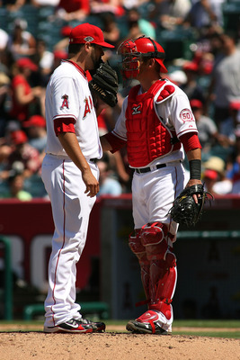 Jordan Walden (left) and Jeff Mathis (right) discuss strategy late in Los Angeles' 4-2 win over Seattle. The win gave the Angels a sweep of Seattle, and some momentum going into the all-star break.