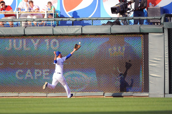 KANSAS CITY, MO - JUNE 24:  Jeff Francoeur #21 of the Kansas City Royals can't make a catch on an eventual triply by Jeff Baker of the Chicago Cubs at Kauffman Stadium on June 24, 2011 in Kansas City, Missouri. (Photo by G. Newman Lowrance/Getty Images)