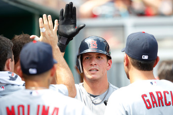 PITTSBURGH - JULY 24: Colby Rasmus #28 of the St Louis Cardinals is congratulated by teammates in the dugout after hitting a solo home run against the Pittsburgh Pirates during the game on July 24, 2011 at PNC Park in Pittsburgh, Pennsylvania.  (Photo by
