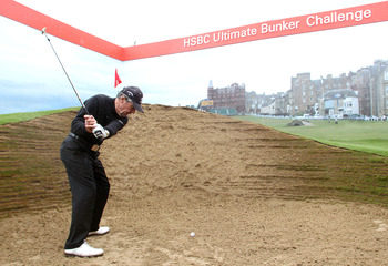 SANDWICH, ENGLAND - JULY 16:  Former Open Champion Gary Player of South Africa paid a visit to the HSBC Golf Zone and tried out the full scale replica of the notorious Road Hole Bunker at St. Andrews during the third round of The 140th Open Championship a