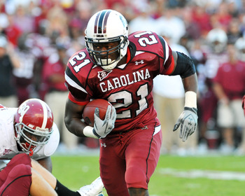 COLUMBIA, SC - OCTOBER 9: Running back Marcus Lattimore #21 of the South Carolina Gamecocks rushes upfield against the Alabama Crimson Tide October 9, 2010 at Williams-Brice Stadium in Columbia, South Carolina.  (Photo by Al Messerschmidt/Getty Images)