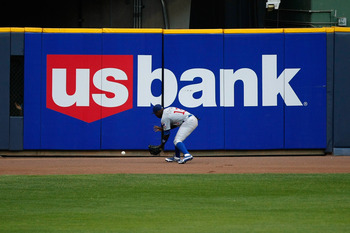 MILWAUKEE, WI - JULY 26: Alfonso Soriano #12 of the Chicago Cubs fields the baseball off the outfield wall against the Milwaukee Brewers at Miller Park on July 26, 2011 in Milwaukee, Wisconsin. (Photo by Scott Boehm/Getty Images)