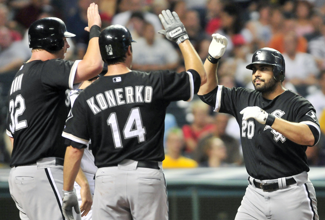 CLEVELAND, OH - JULY 22: Adam Dunn #32 and Paul Konerko #14 celebrate with Carlos Quentin #20 of the Chicago White Sox after his three run home run during the fifth inning against the Cleveland Indians at Progressive Field on July 22, 2011 in Cleveland, O