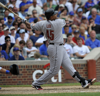 CHICAGO, IL - JULY 24: Carlos Lee #45 of the Houston Astros hits a two-run homer in the eighth inning against the Chicago Cubs on July 24, 2011 at Wrigley Field in Chicago, Illinois. The Cubs defeated the Astros 5-4 in ten innings.   (Photo by David Banks