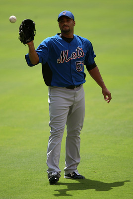 MIAMI GARDENS, FL - JULY 24:  Johan Santana #57 of the New York Mets warms up before a throwing session in the pullpen before the start of a game against the Florida Marlins at Sun Life Stadium on July 24, 2011 in Miami Gardens, Florida.  (Photo by Sarah