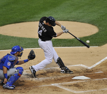 CHICAGO, IL - JUNE 21: Paul Konerko #14 of the Chicago White Sox hits a solo home run against the Chicago Cubs in the second inning on June 21, 2011 at U.S. Cellular Field in Chicago, Illinois.  (Photo by David Banks/Getty Images)