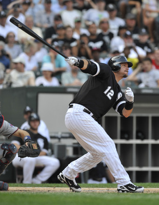 CHICAGO, IL - JULY 09: A.J. Pierzynski #12 of the Chicago White Sox hits a double in the ninth inning against the Minnesota Twins on July 9, 2011 at U.S. Cellular Field in Chicago, Illinois. The White Sox defeated the Twins 4-3.    (Photo by David Banks/G