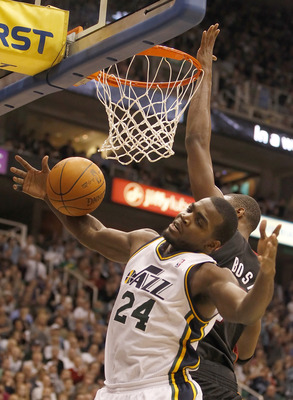 SALT LAKE CITY, UT - DECEMBER 8:  Paul Millsap #24 of the Utah Jazz is fouled by Chris Bosh #1 of the Miami Heat during the second half of an NBA game December 8, 2010 at Energy Solutions Arena in Salt Lake City, Utah. The Heat beat the Jazz 111-98. NOTE