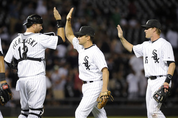 CHICAGO, IL - JUNE 07: (L-R) A.J. Pierzynski # 12, Omar Vizquel #11 and Gordon Beckham #15 of the Chicago White Sox celebrate their victory against the Seattle Mariners on June 7, 2011 at U.S. Cellular Field in Chicago, Illinois. The Sox defeated the Mari