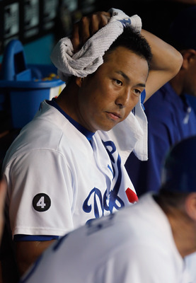 LOS ANGELES, CA - JULY 27:  Hiroki Kuroda #18 of the Los Angeles Dodgers looks on from the dugout prior to the start of the game against the Colorado Rockies at Dodger Stadium on July 27, 2011 in Los Angeles, California.  (Photo by Jeff Gross/Getty Images