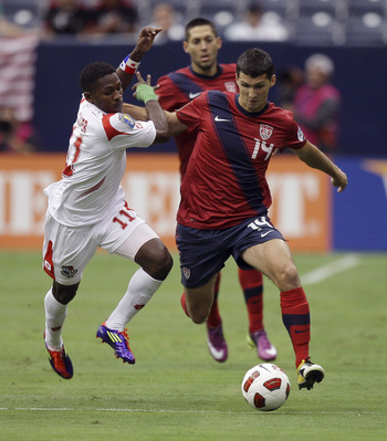 HOUSTON - JUNE 22:  Eric Lichaj #14 of the U.S.A. fights off  Armando Cooper #11 of Panama as he brings the ball up field in the first half at Reliant Stadium on June 22, 2011 in Houston, Texas.  (Photo by Bob Levey/Getty Images)