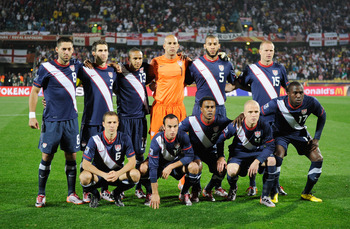 RUSTENBURG, SOUTH AFRICA - JUNE 12:  The USA team (back row L-R) Clint Dempsey, Carlos Bocanegra, Ricardo Clark, Tim Howard, Oguchi Onyewu and Jay Demerit and (front row L-R) Steve Cherundolo, Landon Donovan, Robbie Findley, Michael Bradley and Jozy Altid