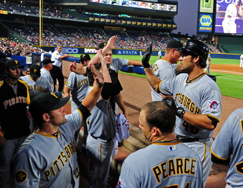 ATLANTA - JULY 27: Garrett Jones #46 of the Pittsburgh Pirates is congratulated by teammates after hitting a 6th inning home run against the Atlanta Braves at Turner Field on July 27, 2011 in Atlanta, Georgia. (Photo by Scott Cunningham/Getty Images)