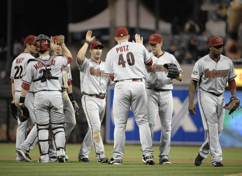 SAN DIEGO, CA - JULY 27:  J.J. Putz #40 of the Arizona Diamondbacks is congratulated by teammates after the Diamondbacks beat the San Diego Padres 4-3 in a baseball game at Petco Park on July 27, 2011 in San Diego, California.  (Photo by Denis Poroy/Getty