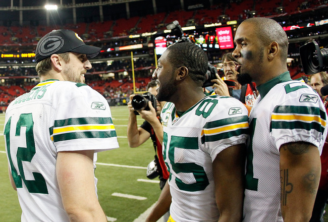 ATLANTA, GA - JANUARY 15:  (L-R) Aaron Rodgers #12, Greg Jennings #85 and Charles Woodson #21 of the Green Bay Packers talk on the sideline late in the fourth quarter against the Atlanta Falcons during their 2011 NFC divisional playoff game at Georgia Dom