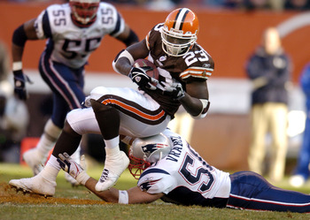 CLEVELAND - DECEMBER 5:  Adimchinobe Echemandu #23 of the Cleveland Browns is tackled by Mike Vrabel #50 of the New England Patriots during the third quarter at Cleveland Browns Stadium on December 5, 2004 in Cleveland, Ohio. The Patriots defeated the Bro